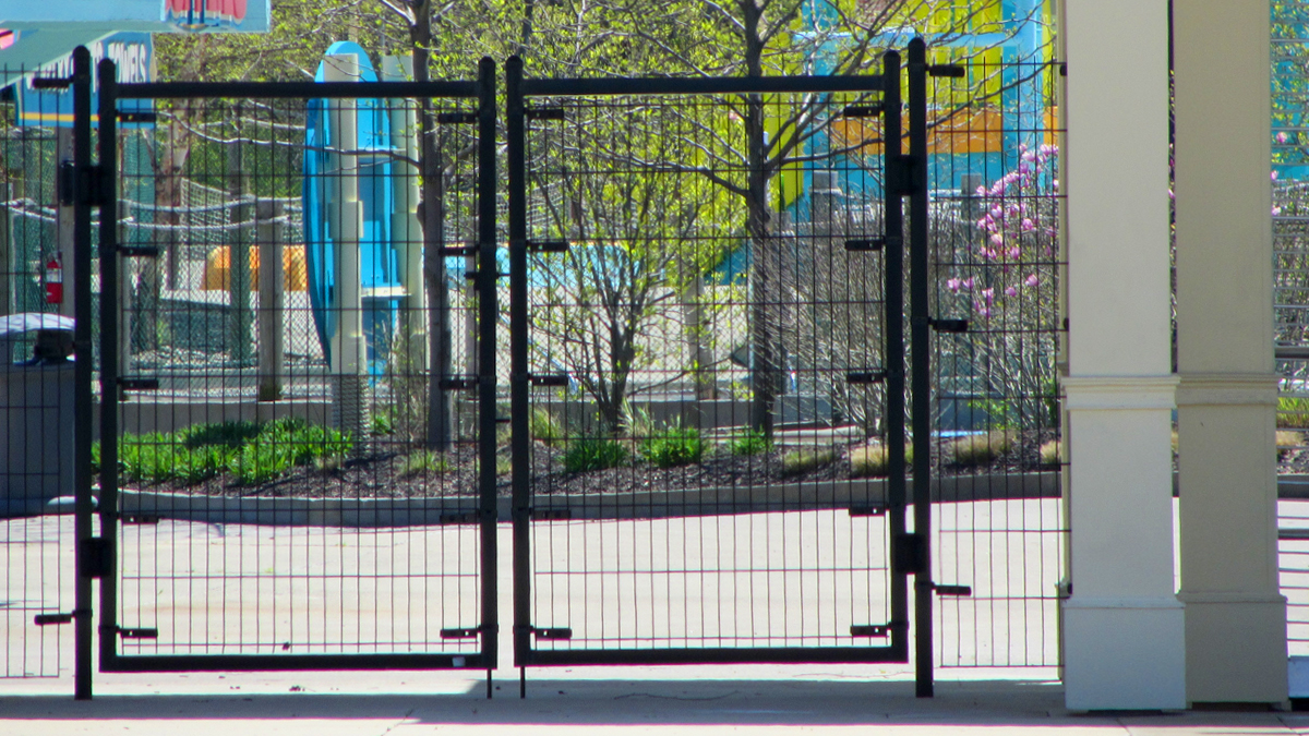 Chain link security gate and fence by Ashlee Fence.