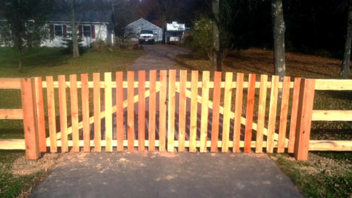 A wood fence and gate will enhance your property's natural beauty.