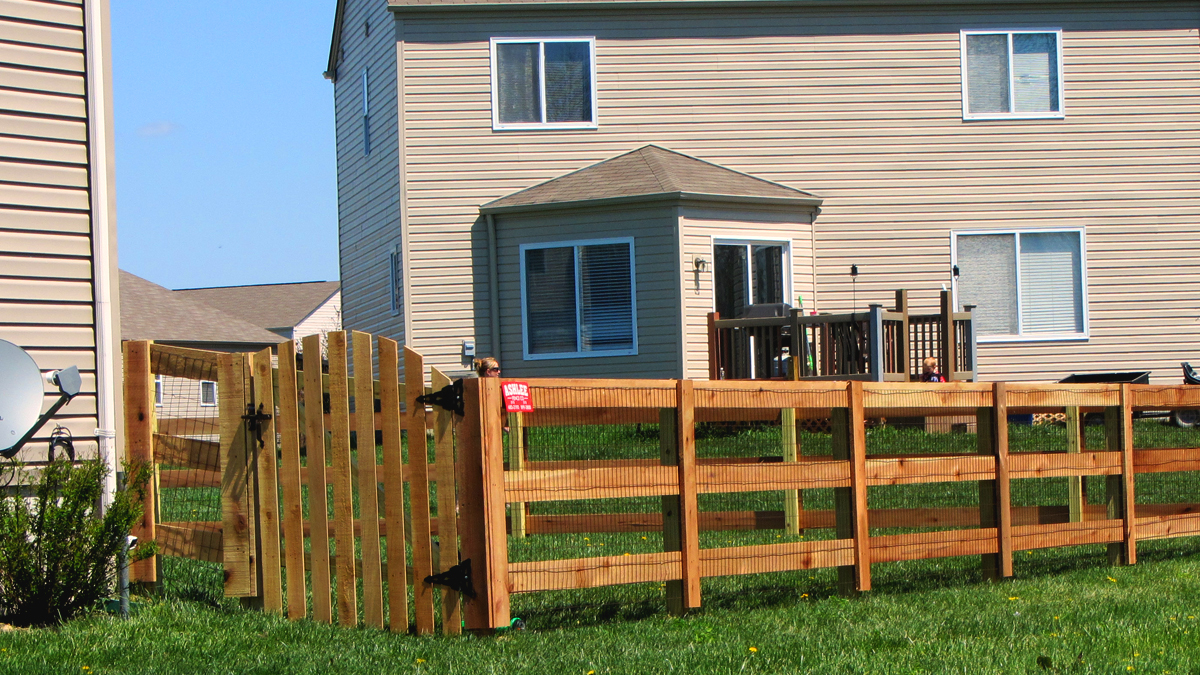 A wood fence is the perfect solution when the safety of children or pets is involved.