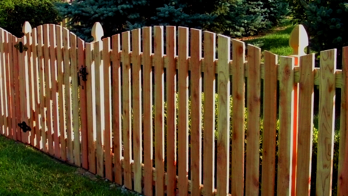Strong, effective and beautiful. Call us today about a wood fence for your home.